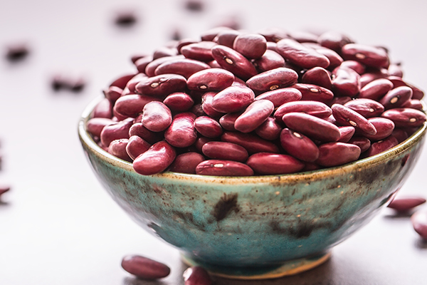 Red beans in bowl on table.