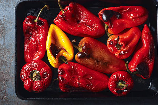 Roasted red and yellow bell peppers in baking tray