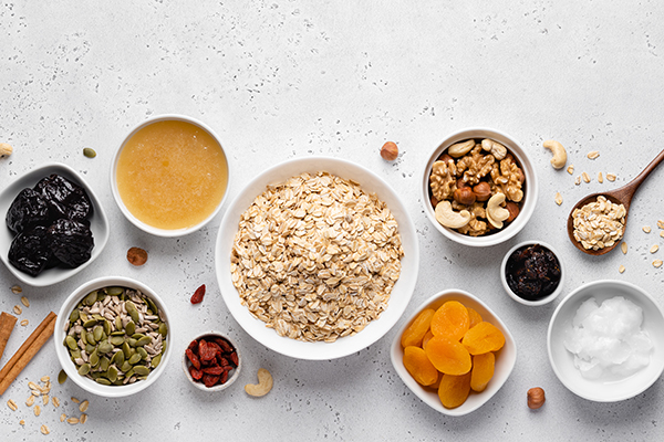 Healthy granola ingredients in small bowls