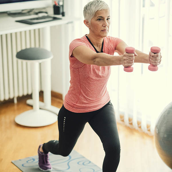 Mature woman strength training at home