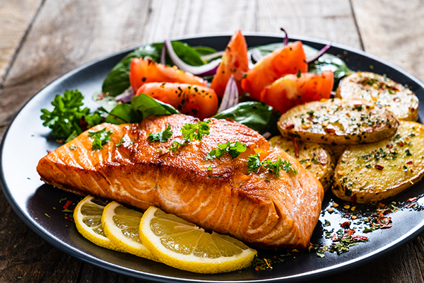 Grilled salmon and vegetables on a plate