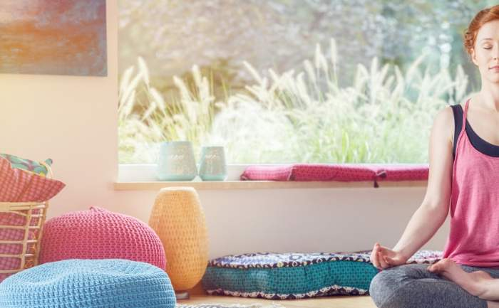 how to focus when meditating- Woman in her meditation space