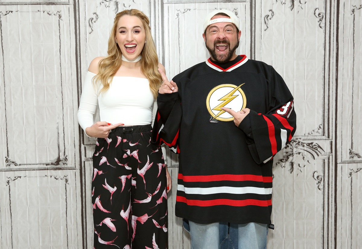 kevin smith and harley quinn smith posing on red carpet