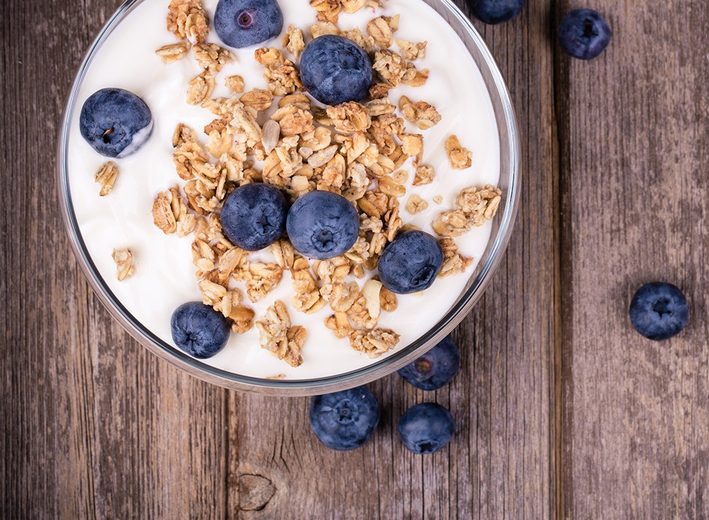 Yogurt in bowl with granola and blueberries - best ways to speed up your metabolism