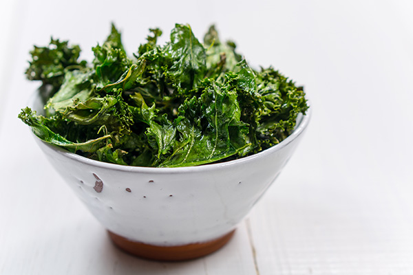 Kale chips in white bowl